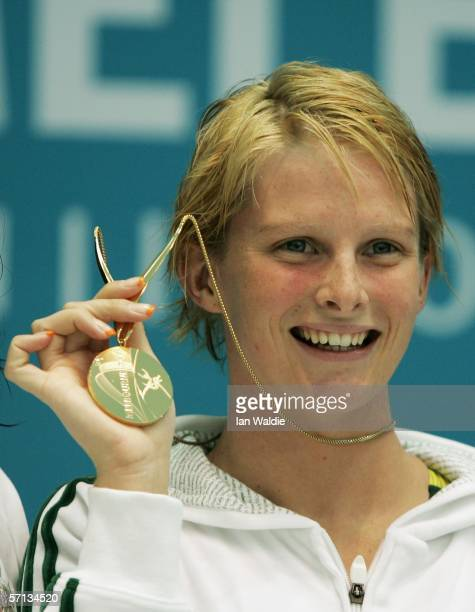 Leisel Jones of Australia poses with her gold medal she won in a new world record time in the women's 100m breaststroke final at the swimming held at...
