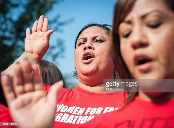 Leisha Carrasquillo Acosta of Charlotte North Carolina takes an oath to fight for immigration reform during the rally in front of the Capitol in...
