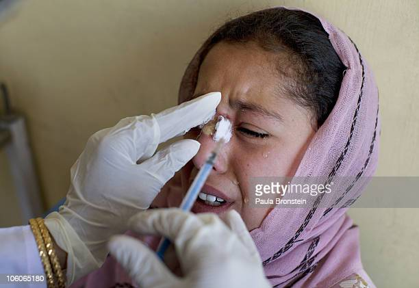 A leishmaniasis patient cries while getting a painful injection of Sodium Stibogluconate at a free specialized clinic for Leishmaniasis supported by...