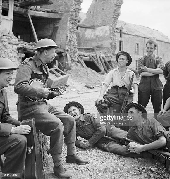 Leisure And Entertainment During The Second World War George Formby entertains a group of soldiers in the ruins of a village in Normandy during the...