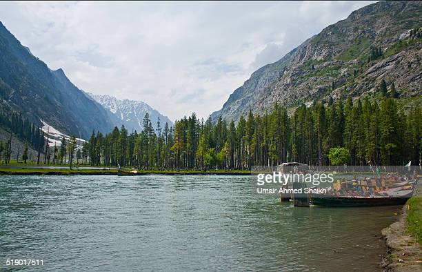 leisure boats on lake mahudand - swat valley stock pictures, royalty-free photos & images