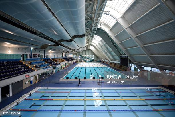 Leisure centre manager Ryan Walker inspects the facilities in the main swimming pool hall of the Manchester Aquatics Centre, which remains closed to...
