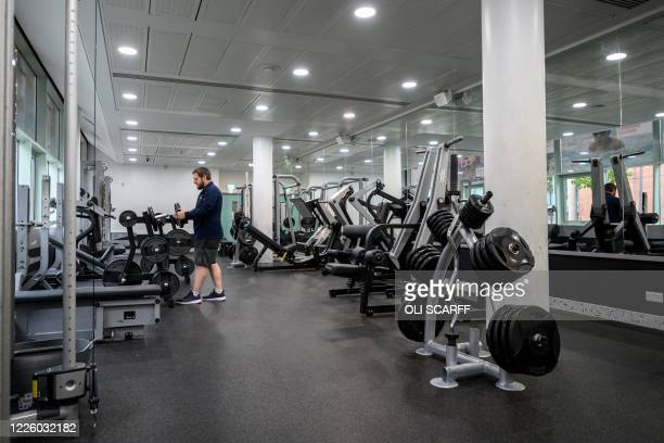 Leisure centre manager Ryan Walker inspects the facilities in the performance gym of the Manchester Aquatics Centre which remains closed to the...