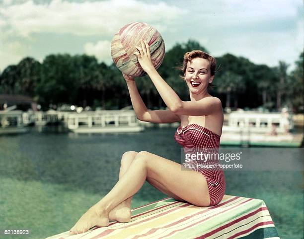 circa 1950's Florida USA Florence Winfree with beachball wearing a swimsuit typical of that era