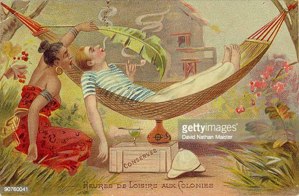 �Leisure Hours in the Colonies� Postcard showing relaxed life in the French colonial possessions with a glass of absinthe to hand
