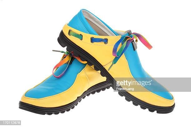 leisure shoes on white background - yellow shoe stock photos and pictures
