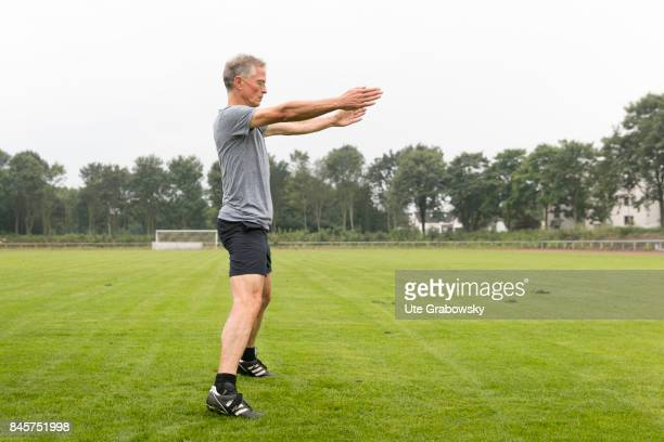 Leisure sports and personal fitness A man is doing some relaxation exercise after a workout on a sports field Staged picture on August 10 2017 in...