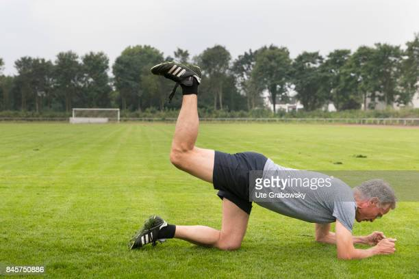 Leisure sports and personal fitness On a sports ground a man makes a quadruple stand and lifts his leg upwards Staged picture on August 10 2017 in...