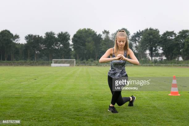Leisure sports personal fitness A young girl is training her thighs on a sports field Staged picture on August 10 2017 in Duelmen Germany