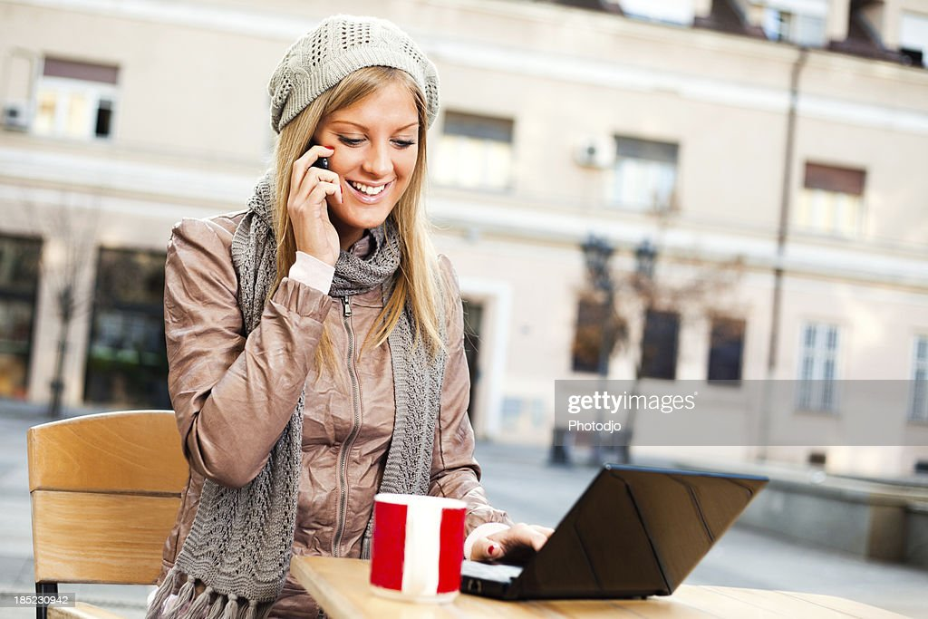 Leisure time in a cafe : Stock Photo