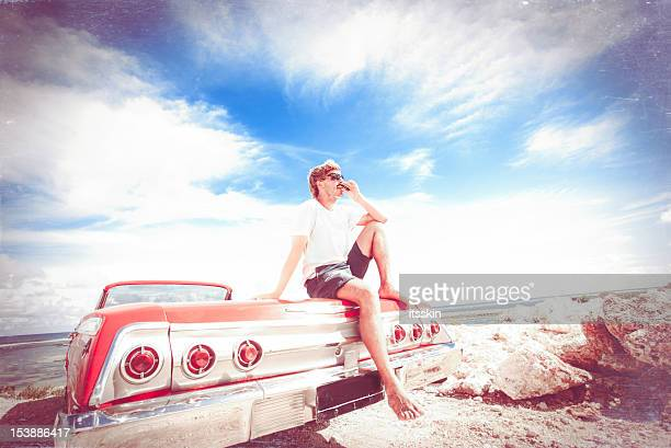 leisure time - muscle men at beach stock photos and pictures