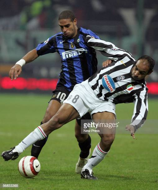 Leite Adriano of Inter Milan competes with Emerson Ferreira da Rosa of Juventus during the Serie A match between Inter Milan and Juventus at the...