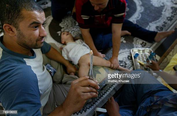 Leith Fuad Mosa age 3 after being circumcised on June 29 2007 in Baghdad Iraq Circumcision the procedure that removes part or all of the foreskin...