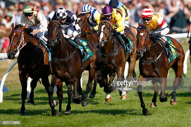 Leith Innes riding Kawi wins the Zabeel Classic during the Boxing Day races at Ellerslie on December 26 2015 in Auckland New Zealand