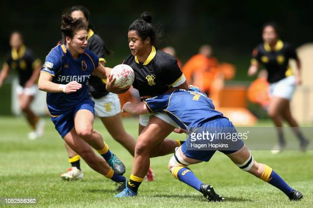 Leitliga Ayesha of Wellington is tackled by Georgia Mason and Sheree Hume of Otago during the Farah Palmer Cup Championship Final match between the...