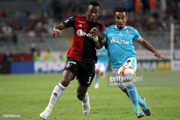 Leiton Jimenez of Atlas vies for the ball with Camilo da Silva of Queretaro during their Mexican Apertura 2018 tournament football match at the...