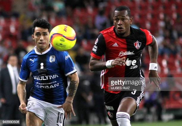 Leiton Jimenez of Atlas vies for the ball with Edson Puch of Queretaro during their Mexican Clausura 2018 tournament football match at the Jalisco...