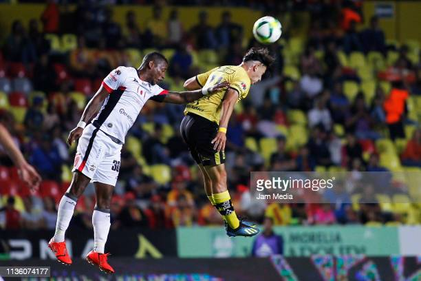 Leiton Jimenez of Lobos BUAP fights for the ball with Carlos Sebastian Ferreira of Morelia during the 11th round match between Morelia and Lobos BUAP...