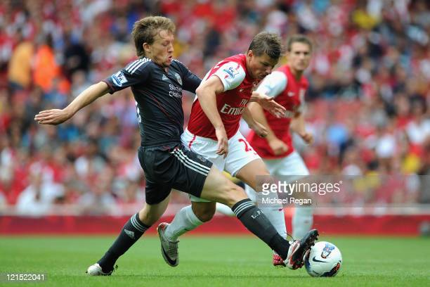 Leiva Lucas of Liverpool tackles Andrey Arshavin of Arsenal during the Barclays Premier League match between Arsenal and Liverpool at the Emirates...