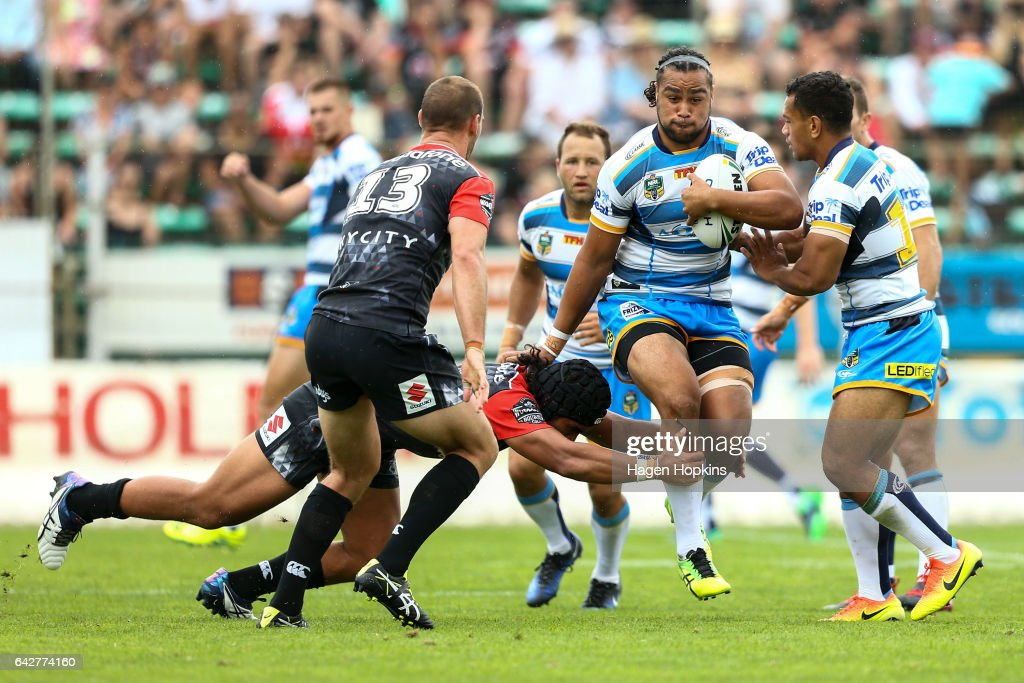 Leivaha Pulu of the Titans is tackled by Isaiah Papalii of the Warriors during the NRL Trial match between the Warriors and the Gold Coast Titans at Central Energy Trust Arena on February 19, 2017 in Palmerston North, New Zealand.