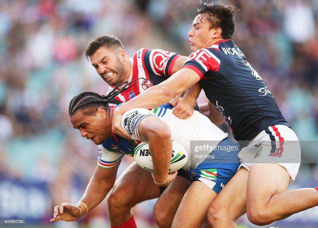 Leivaha Pulu of the Warriors beats James Tedesco (L) and Joseph Manu (R) of the Roosters to score a try during the round four NRL match between the Sydney Roosters and the New Zealand Warriors at Allianz Stadium on March 31, 2018 in Sydney, Australia.