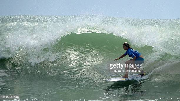 Lekay Peterson of the USA surfs a wave during an international surfing event at Sri Lanka's eastern coastal resort of Arugam bay on September 4,...