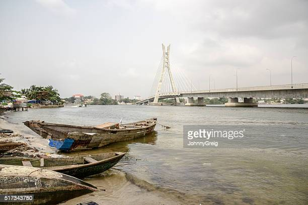 lekki ikoyi bridge with fishing boat, lagos, nigeria - suspension bridge stock photos and pictures