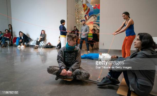 Lela Pierce for the Aniccha Arts team pulled Kelley Meister left and Cassandra Velociraptor during a performance at the Weisman Art Museum Sunday...