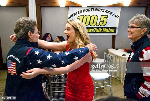 Lela Richardson of Westbrook hugs Carmen Footer of Freeport one of the Freeport Flag Ladies as Elaine Green right looks on at the Mainers for Trump...