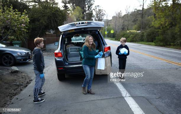 Lelah Nichol the wife David Nichol the owner of Sociale delivers meals with her two sons Julian and Ellis on March 27 2020 in San Francisco...