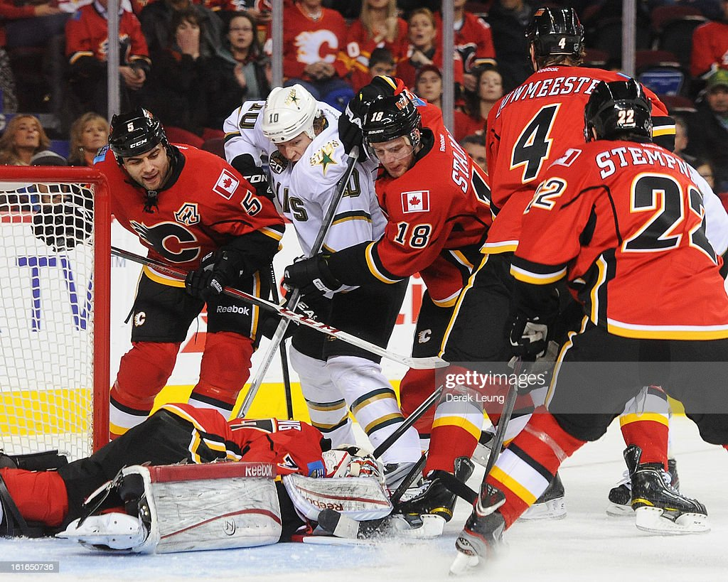 Leland Irving #37 of the Calgary Flames jumps on the puck to stop the rebound of Brenden Morrow #10 of the Dallas Stars during an NHL game at Scotiabank Saddledome on February 13, 2013 in Calgary, Canada. Flames won 7-4.