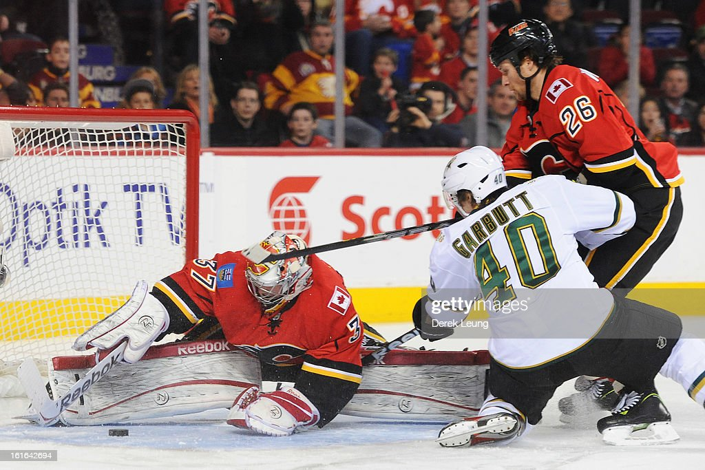 Leland Irving #37 of the Calgary Flames stops the shot of Ryan Garbutt #40 of the Dallas Stars during an NHL game at Scotiabank Saddledome on February 13, 2013 in Calgary, Canada.