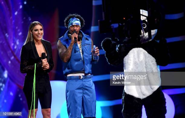 Lele Pons and Nick Cannon speak onstage during FOX's Teen Choice Awards at The Forum on August 12 2018 in Inglewood California