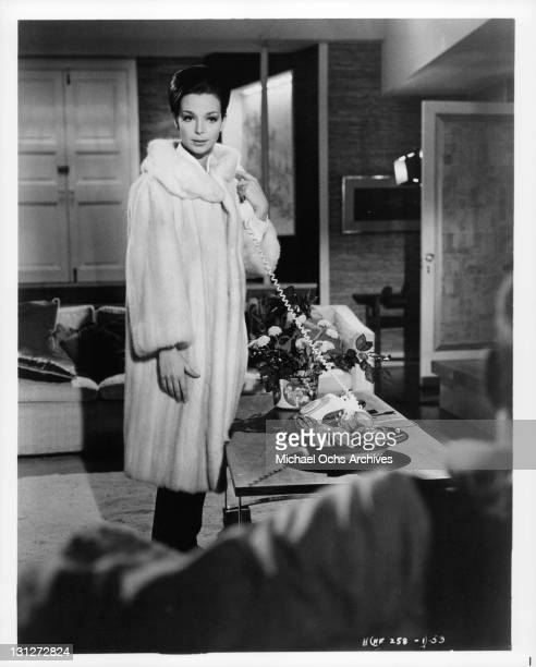 Lelia Goldoni standing in a fur coat in a scene from the film 'Hysteria' 1965