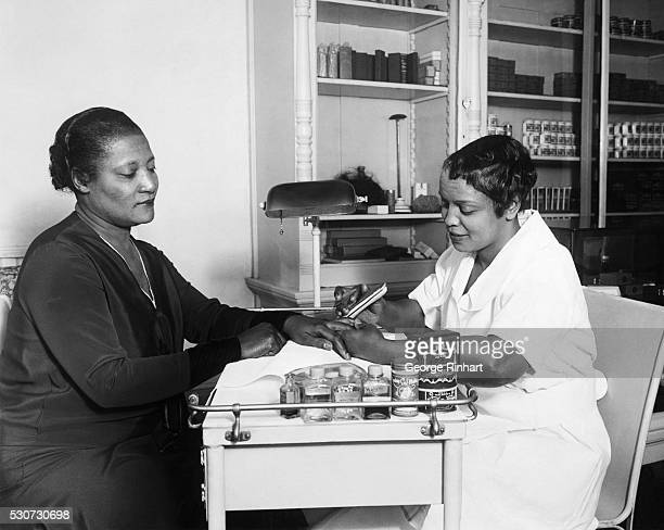 Lelia Walker, daughter of Madame C. J. Walker, gets a manicure at one of her mother's beauty shops. Madame C. J. Walker made a fortune from her chain...