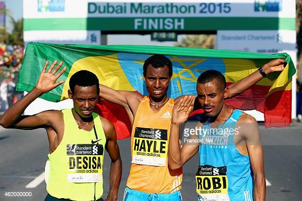 Lelisa Desia Benti of Ethiopia Lemi Berhanu Hayle of Ethiopia and Deirbe Robi Meka of Ethiopia pose for a picture after the Standard Chartered Dubai...