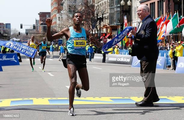 Lelisa Desisa Benti of Ethiopia crosses the finish line to win the men's division of the 117th Boston Marathon on April 15, 2013 in Boston,...