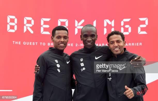 Lelisa Desisa Eliud Kipchoge and Zersenay Tadese celebrate the Nike Breaking2 SubTwo Marathon Attempt at Autodromo di Monza on May 6 2017 in Monza...