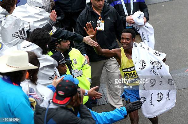 Lelisa Desisa of Ethiopa celebrates after winning the 119th Boston Marathon on April 20 2015 in Boston Massachusetts