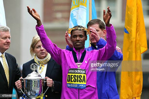 Lelisa Desisa of Ethiopa is presented with the laurel wreath by Boston Mayor Marty Walsh after winning the 119th Boston Marathon on April 20 2015 in...
