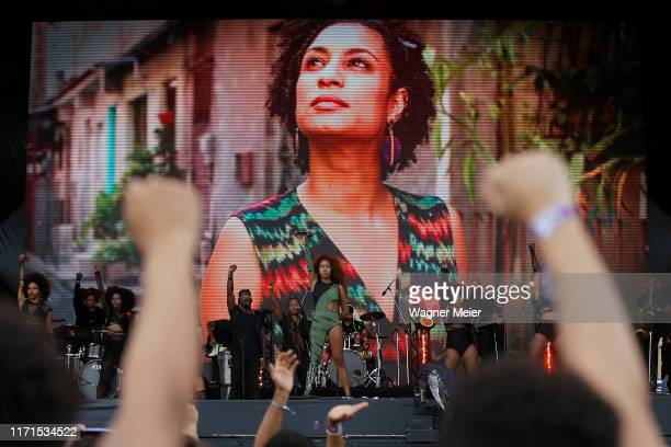 Lellê e Blaya band members pay tribute to murdered Brazilian politician Marielle Franco on the Sunset stage during Rock in Rio 2019 at Cidade do Rock...