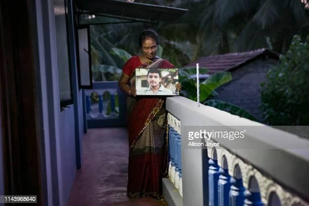 Lelladevi Anadanadarajah holds a photo of son Anuraj Anadanadarajah May 13 2019 in Kilinochchi Sri Lanka Lelladevi Anadanadarajahs son Anuraj...