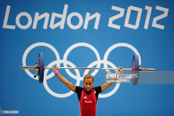 Lely Berlitt Burgos Ortiz of Puerto Rico competes in the Women's 48kg Group A weightlifting on Day 1 of the London 2012 Olympic Games at ExCeL on...