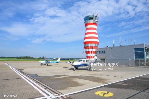 Lelystad airport tarmac with two airplanes on the tarmac and the air traffic control tower on September 14, 2021 in Lelystad, The Netherlands. The...