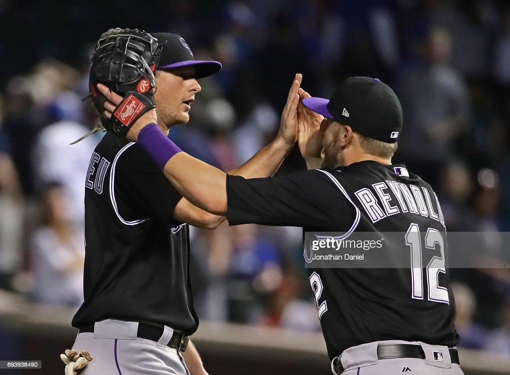 DJ LeMahieu #9 (L) and Mark Reynolds #12 of the Colorado Rockies celebrate a win over the Chicago Cubs at Wrigley Field on June 8, 2017 in Chicago, Illinois. The Rockies defeated the Cubs 4-1.