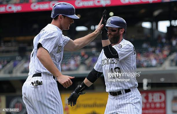 LeMahieu and Nolan Arenado of the Colorado Rockies celebrate as they score on a triple by Nolan Arenado of the Colorado Rockies to take a 20 lead...