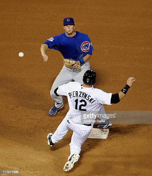 LeMahieu of the Chicago Cubs turns a double play as AJ Pierzynski of the Chicago White Sox slides in at US Cellular Field on June 20 2011 in Chicago...