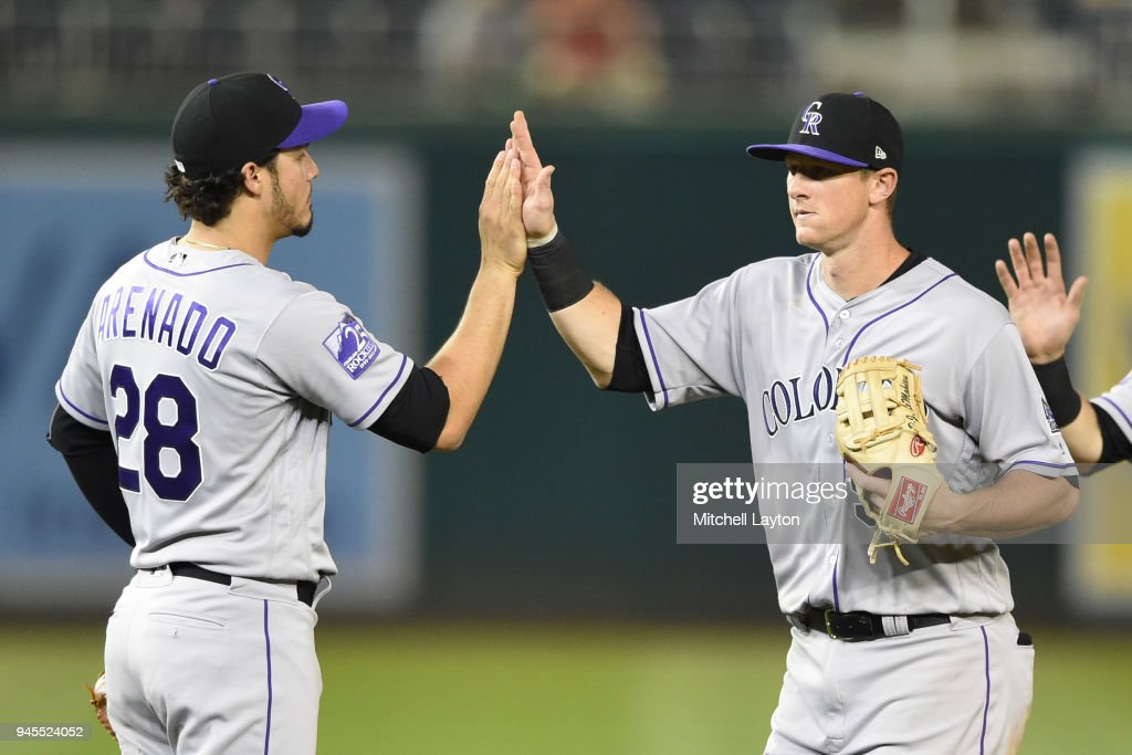 DJ LeMahieu #9 of the Colorado Rockies celebrates a win with Nolan Arenado #28 of the Colorado Rockies after a baseball game against the Washington Nationals at Nationals Park on April 12, 2018 in Washington, DC.