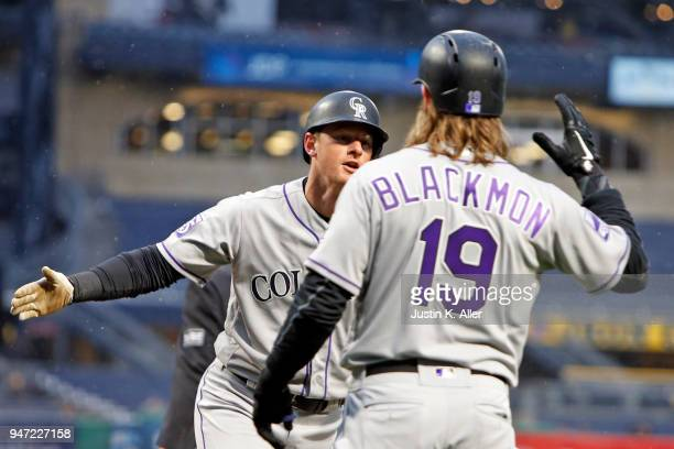 LeMahieu of the Colorado Rockies celebrates after scoring on an RBI double in the first inning against the Pittsburgh Pirates at PNC Park on April 16...