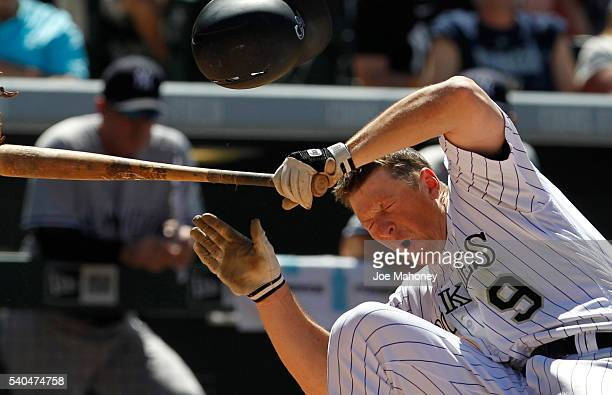 LeMahieu of the Colorado Rockies falls after being hit in the head by a pitch thrown by pitcher Anthony Swarzak of the New York Yankees in the sixth...